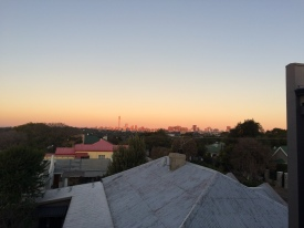 The sunset and the city from our balcony