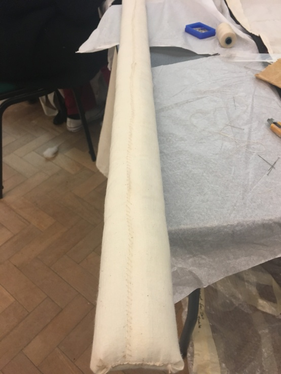 hand sewn pole for textile